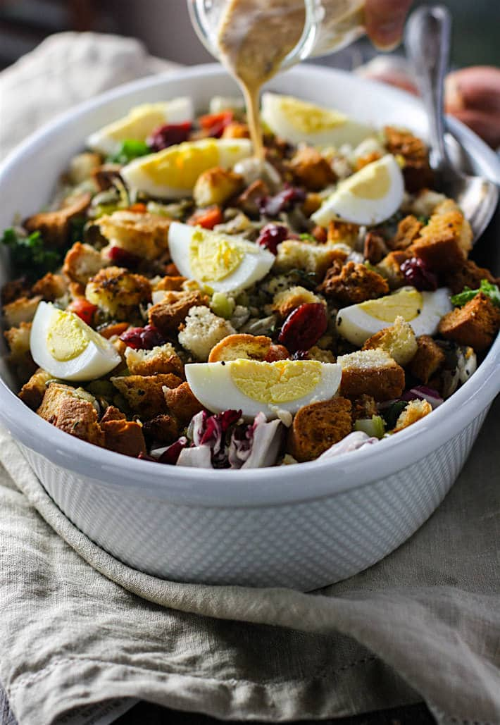 Gluten Free Stuffing Salad with Sweet Onion Dressing! A Gluten Free Stuffing recipe with a twist! This easy Holiday side dish combines the comfort food of traditional stuffing with a healthy winter salad! All tossed together in no time and served with a warm sweet onion dressing. A healthy stuffing recipe that is light and flavorful.