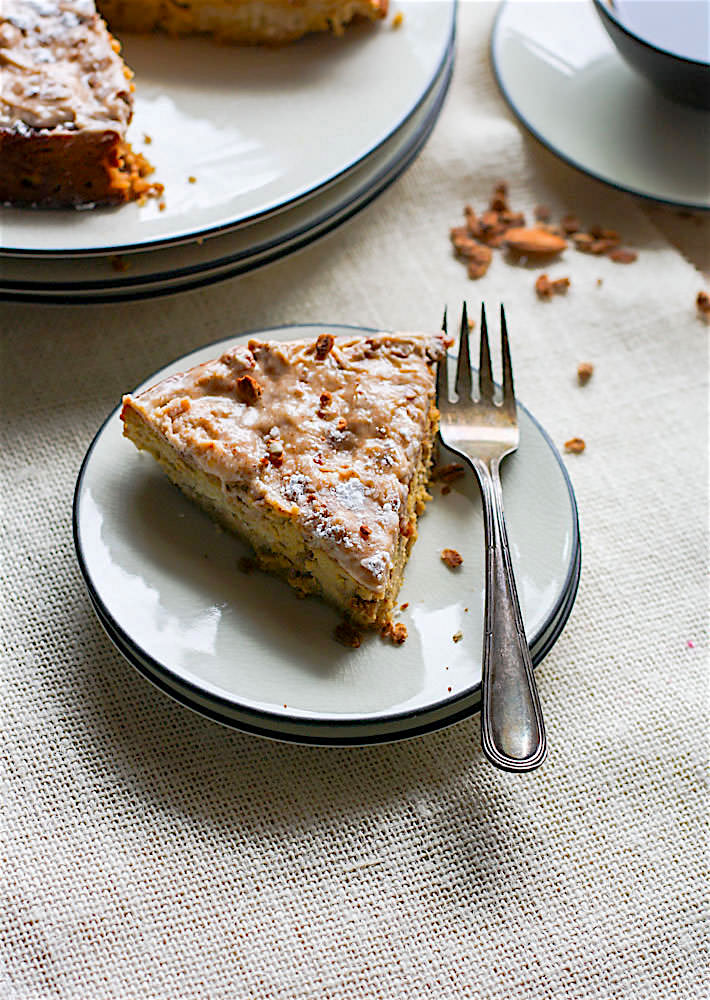 Grain Free White Chocolate Spiced Almond Cake! A healthy holiday twist on the classic almond cake! Cinnamon Spiced almond cake with melted white chocolate and a cinnamon cream cheese topping.Taste so decadent but is actually pretty healthy and easy to make. A perfect moist cake recipe for those looking to enjoy gluten free desserts.