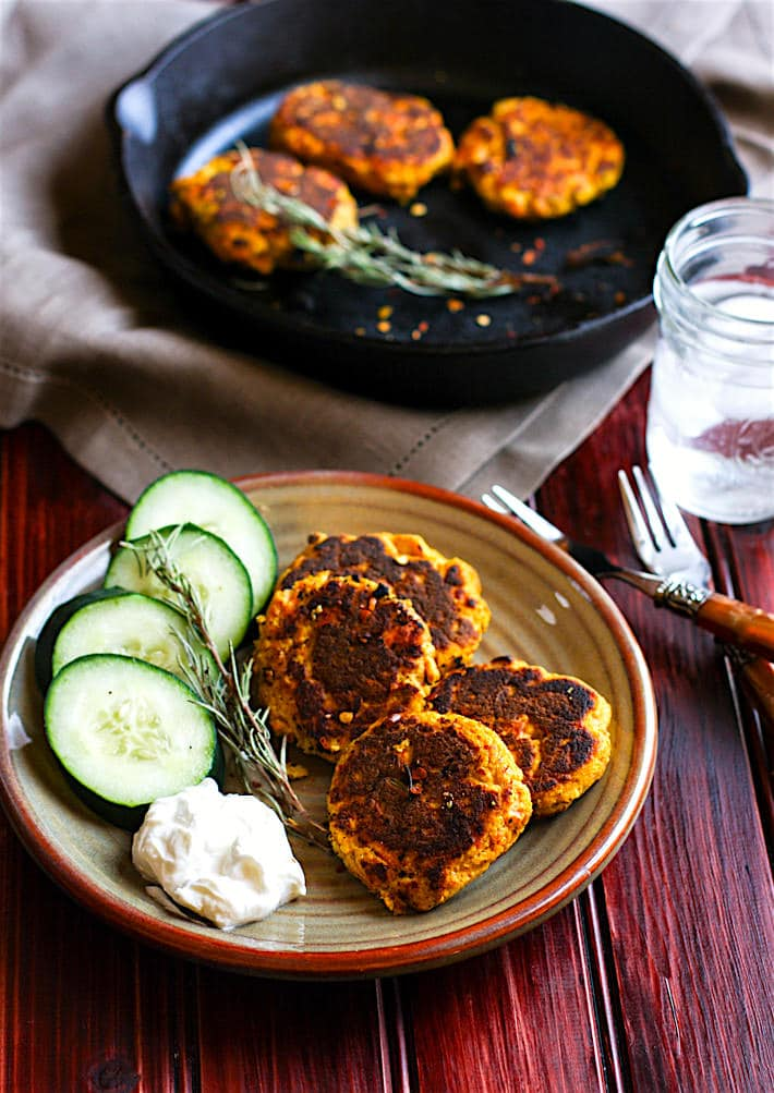 Healthy Vegetable Packed Paleo Salmon Cakes! Super easy, super simple, super delicious! These Paleo salmon cakes take little time. Salmon Cakes that are literally veggie packed and protein packed! Just butternut squash, herbs, egg, salmon, and spices! No wasting leftovers here, just mix and throw on a skillet. Great for a healthy meal, snacks, party appetizers, and are freezer friendly. www.cottercrunch.com