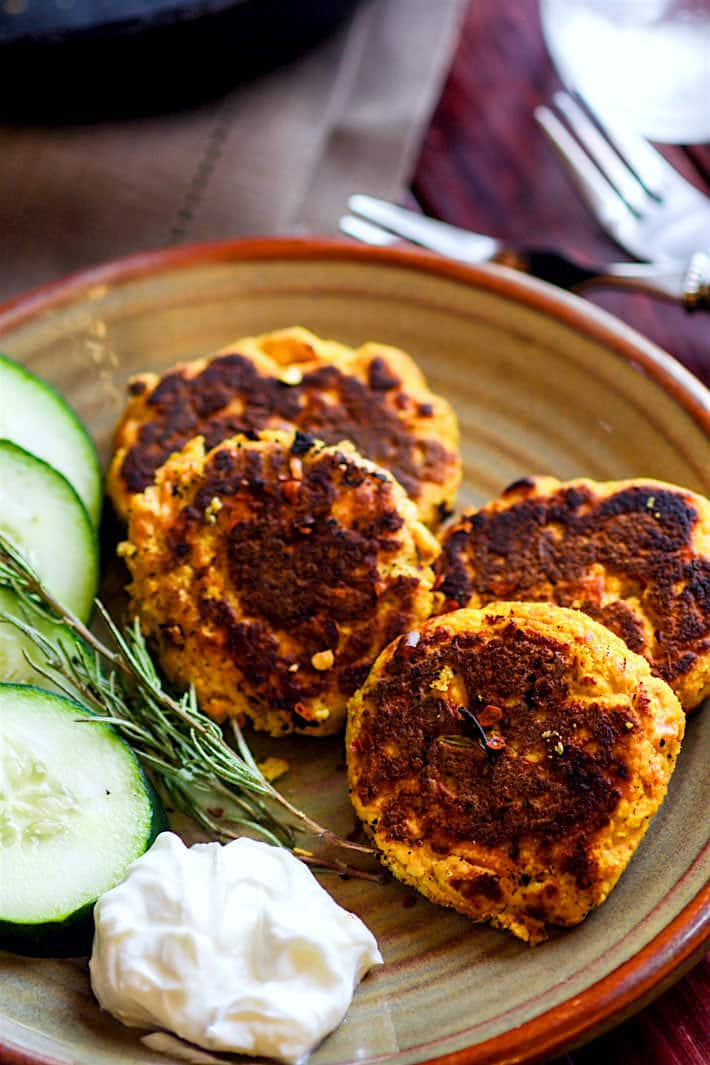 Paleo salmon cakes that are veggie packed and protein packed! Just butternut squash, herbs, egg, salmon, and spices! No wasting leftovers here, just mix and throw on a skillet., cottercrunch.com