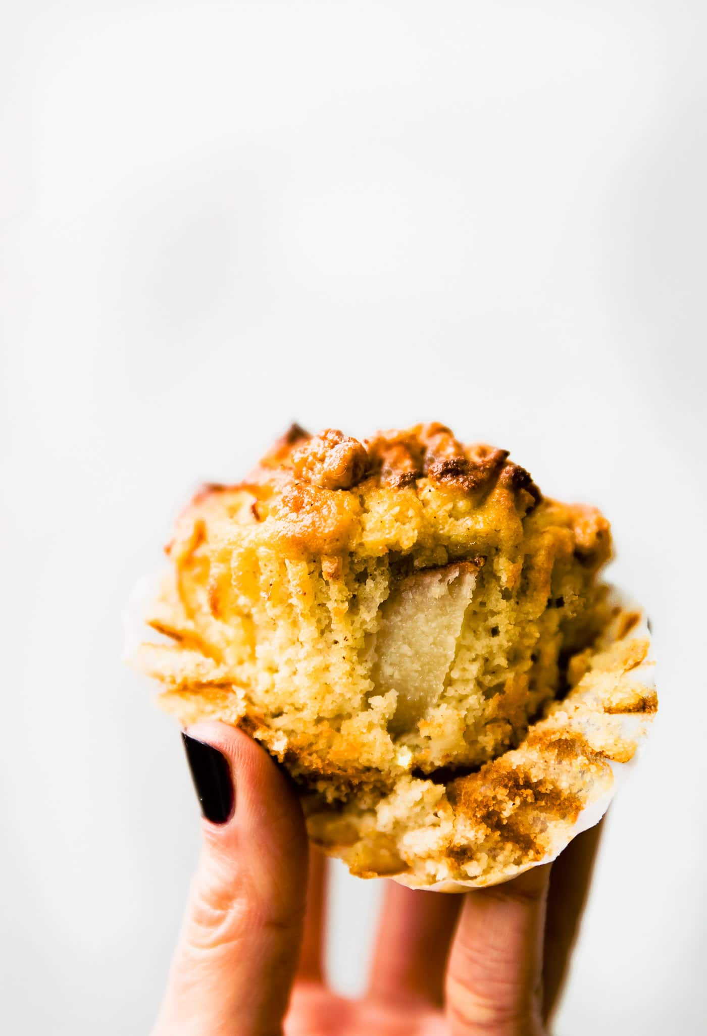 Grain free Spiced Pear Muffins with a sweet nutty topping! Delicious, easy to make paleo muffins (paleo friendly that is) that are Light, fluffy, and naturally sweetened.