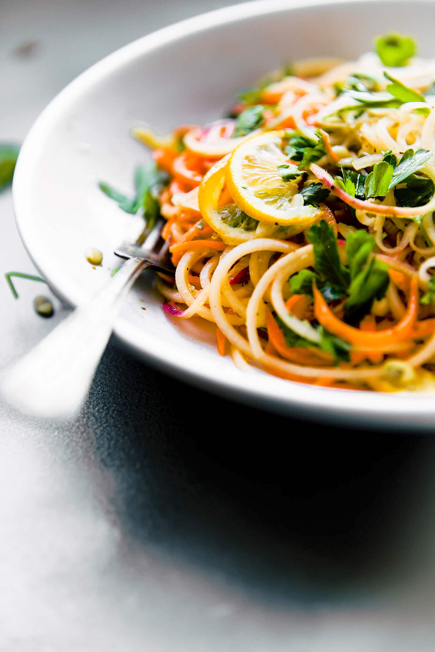 Carrot Celeriac Spiralized Salad in bowl with fork