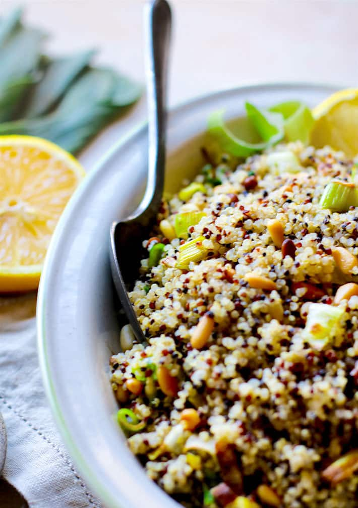 Gluten Free Honey Toasted Pine Nut and Leek Quinoa Salad! A simple yet slightly sweet and zesty quinoa salad that is perfect for any occasion! A great healthy side dish or even a simple lunch idea! Dairy free and vegan friendly. Freezable and ready in 30 minutes.