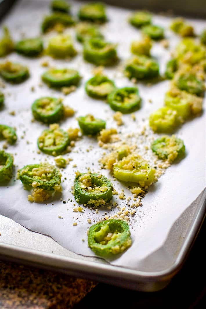 low carb baked jalapeno cheese crisps - bake your jalapeno slices first.