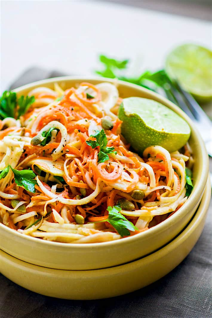 Light Carrot Celeriac Spiralized Salad! This root vegetable spiralized salad is s simple and healthy to make, not to mention delicious! A paleo, vegan, and low carb noodle salad option you can make under 30 minutes. Celeriac is light and low carb but extremely versatile!