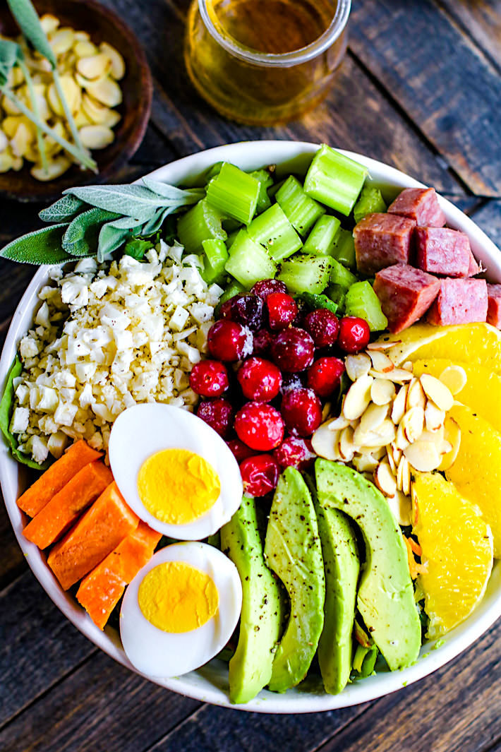 Winter's Bounty Paleo Cobb Salad! Take advantage of seasonal produce and make this healthy Paleo Cobb Salad that's fit for a king! It's packed with, flavor, protein, healthy fats, and LOADS of seasonal fruits and veggies! You'll love how easy and delicious is to make for one or for the whole family.