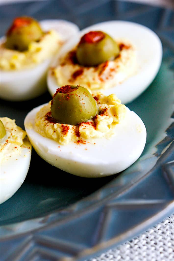 Creamy Olive Deviled Eggs- low carb, healthy, and packed with Vitamin D, E, and Calcium! Great appetizer or pot uck recipe!