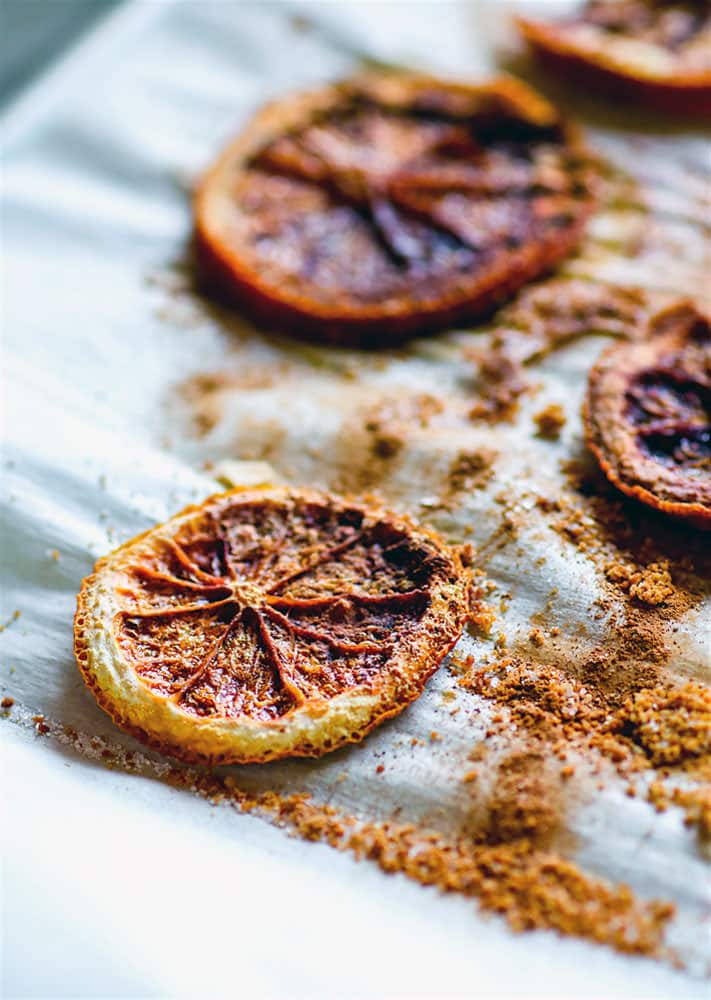 Oven dried orange slices. Slightly sweetened oven dried orange slices sprinkled with spices and coconut sugar. Great with cocktails, garnishing, or cereals.