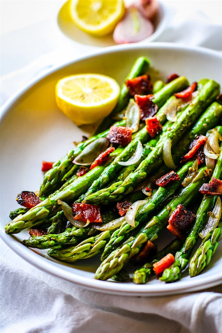 Easy Peppered Candied Bacon and Asparagus It's paleo, gluten free, and super simple to make! Bacon and Asparagus; a side dish match made in heaven.