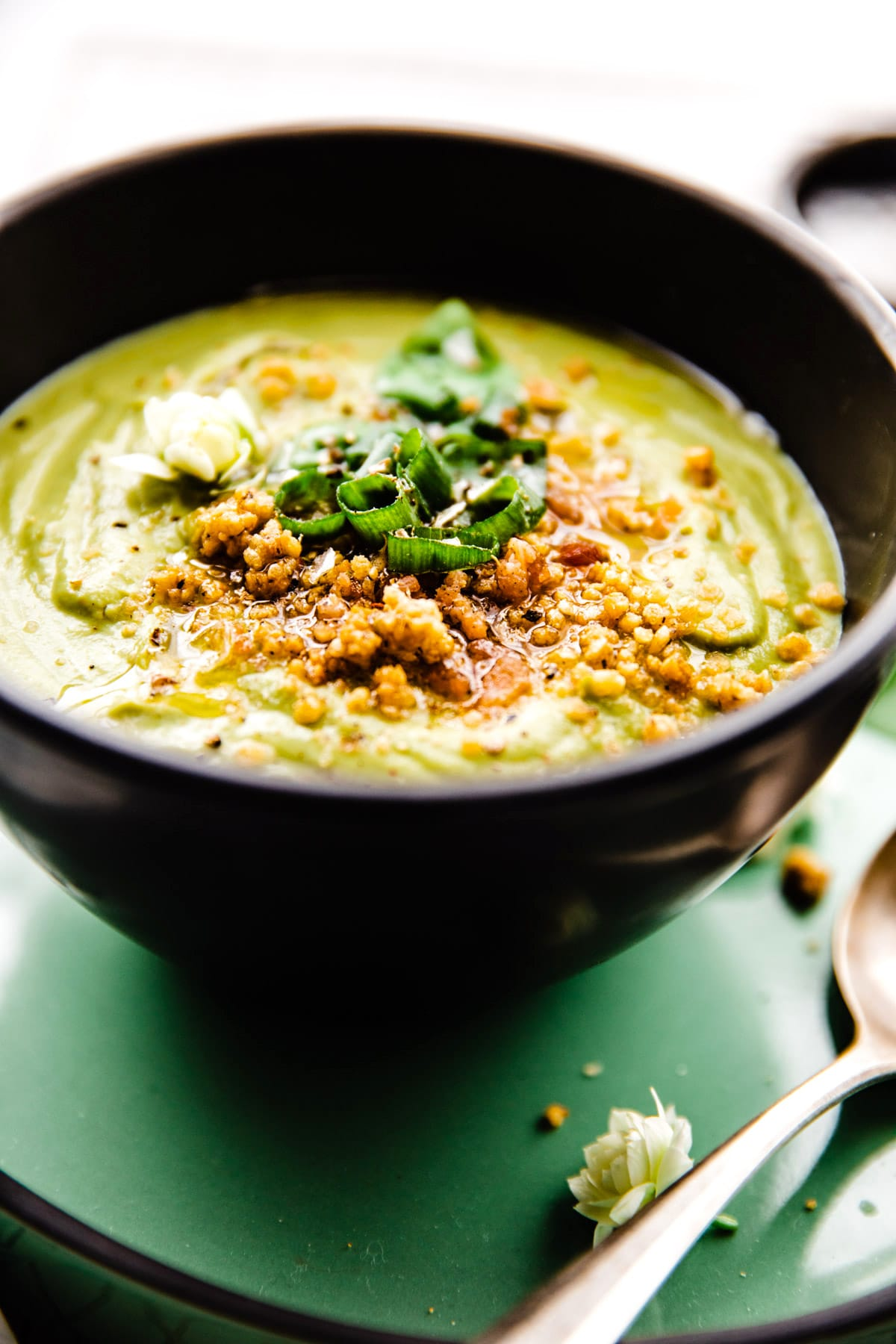 Creamy Artichoke Pea Soup in black bowl