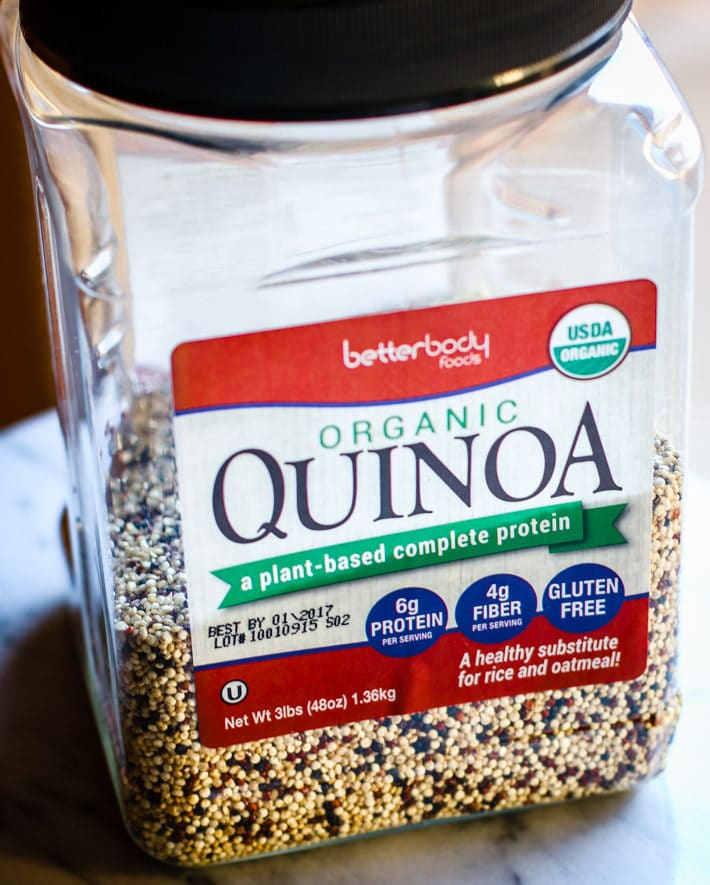plastic container of BettyBody Foods organic quinoa