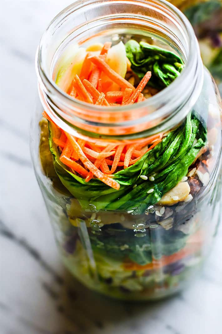 Easy Oriental Chicken Bok Choy Mason Jar Salads! Light, Gluten Free, and Paleo friendly oriental style mason jar salads that are great for lunch or dinners on the go! Perfect use of leftover vegetables and grilled or stir fried chicken as well. Portable and Healthy