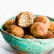 no bake cinnamon vanilla breakfast protein bites in green bowl