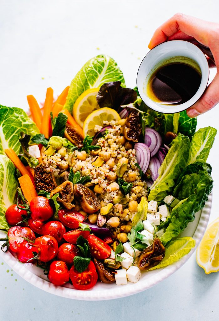 overhead image: bowl of chickpea and quinoa Moroccan salad