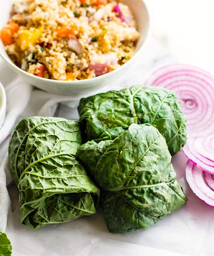 Gluten Free California Quinoa Salad Collard Wraps with Edamame Pesto. A delicious vegan California Quinoa Salad all wrapped up in healthy greens. The pesto adds a punch of plant based protein which makes this a nutritious power lunch