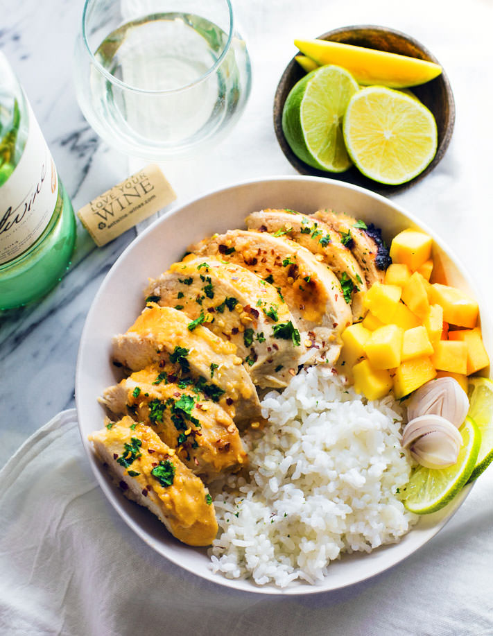 Time to find the perfect marinated chicken recipe you over and over again! Like this Gluten Free Chili-Lime Mango Marinated Chicken Bowl recipe. This Marinated Chicken recipe is super easy to make, healthy, dairy free, and delicious! A great way to learn how to cook with wine and use it in a light marinade.
