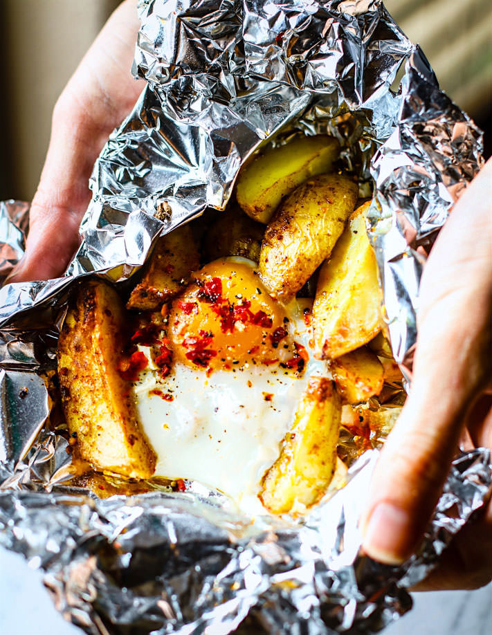 Indian Spiced baked potatoes and egg foil packets. A Gluten Free, Paleo friendly, and vegetarian foil packet meal that rocks with flavor and keeps you healthy! Easy to make with simple real food ingredients and easy to clean up! Great for breakfast, brunch, or dinner.