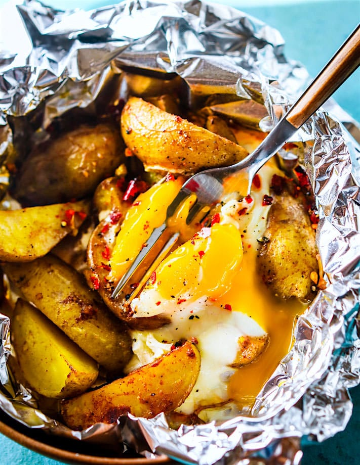 Indian Spiced baked potatoes and egg Foil packets. A Gluten Free and Paleo friendly vegetarian foil packet meal that rocks with flavor and keeps you healthy! Easy to make with simple real food ingredients and easy to clean up! Great for breakfast, brunch, or dinner.