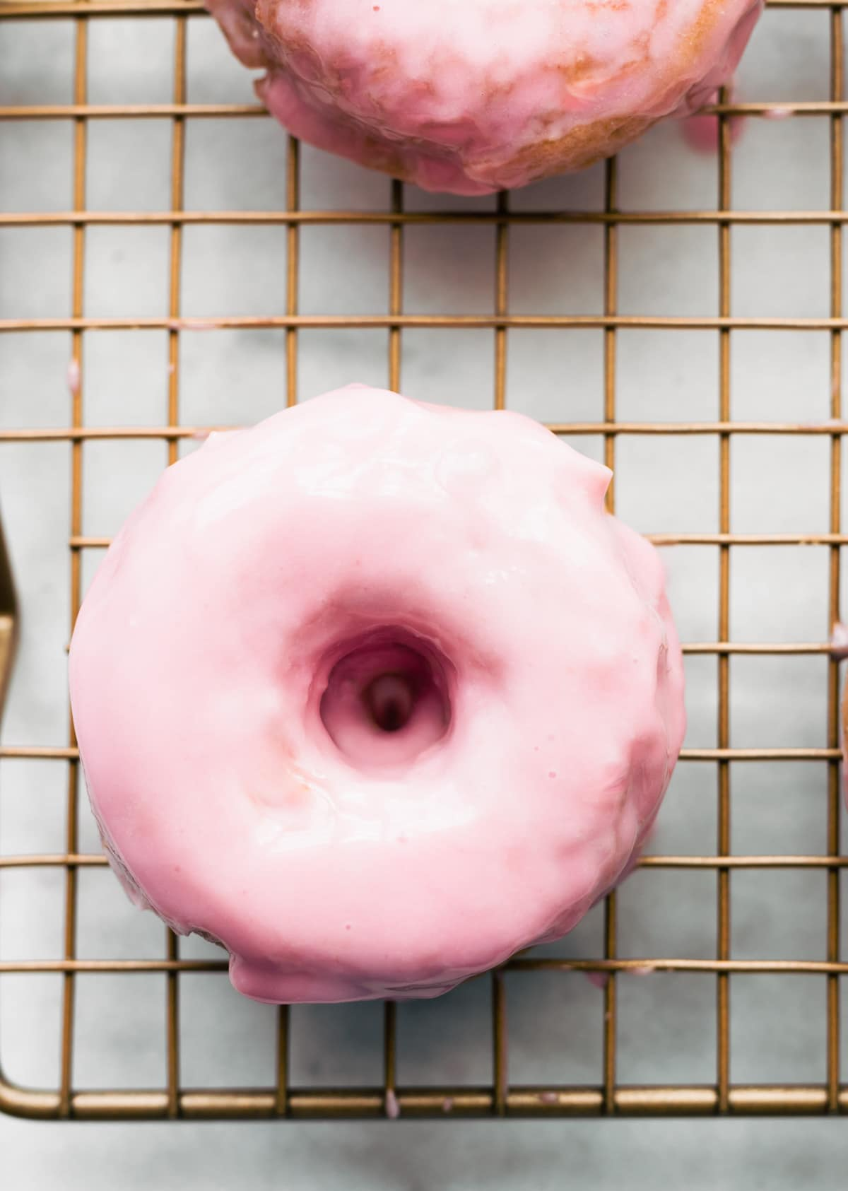 Gluten Free, healthy strawberry cake donut with pink (strawberry) glaze