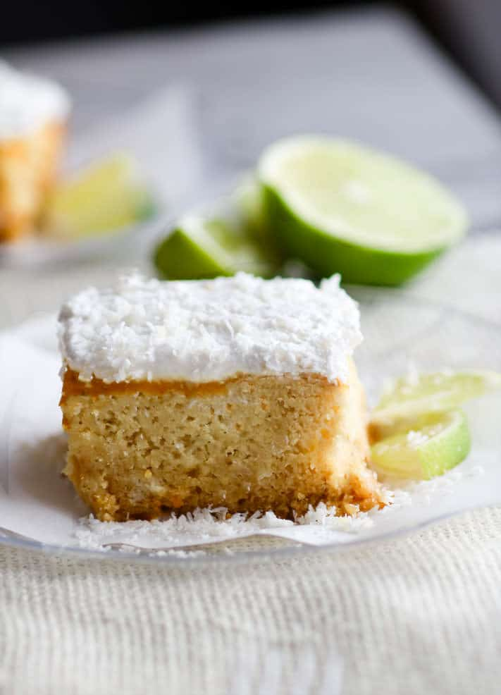 Super EASY gluten free lemon lime coconut vegan cake topped with fluffy whipped coconut cream frosting. An allergy friendly vegan cake that's perfect for Spring/Summer and so simple to make! All you need are a few REAL FOOD ingredients and 45 minutes to bake.