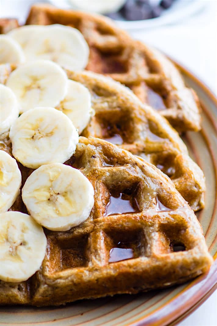 Super EASY Blender Rice Banana Gluten Free Waffles! Just blend and pour for these dairy free and gluten free Waffles. Freezer friendly, made with simple real FOOD ingredients, perfect fuel for breakfast or for a delicious Weekend Breakfast. Vegan option as well!