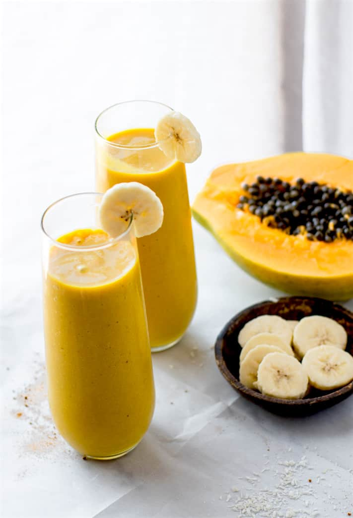 Anti-inflammatory boosting Tropical Turmeric Golden Milk Smoothie! A paleo and vegan friendly smoothie packed with the mega nutrients from turmeric tea golden milk and tropical fruit combined! Packed with fiber, healthy fats, and a whole lotta nourishment!