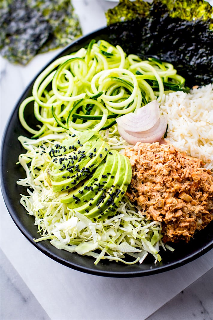 Super Simple Spicy avocado tuna salad sushi bowls. A naturally gluten free and low mercury tuna salad mixed with fun sushi ingredients, then tossed all in a bowl. This is a tuna salad for sushi lovers or anyone looking for a great healthy lunch! Full of omegas, protein, and more.