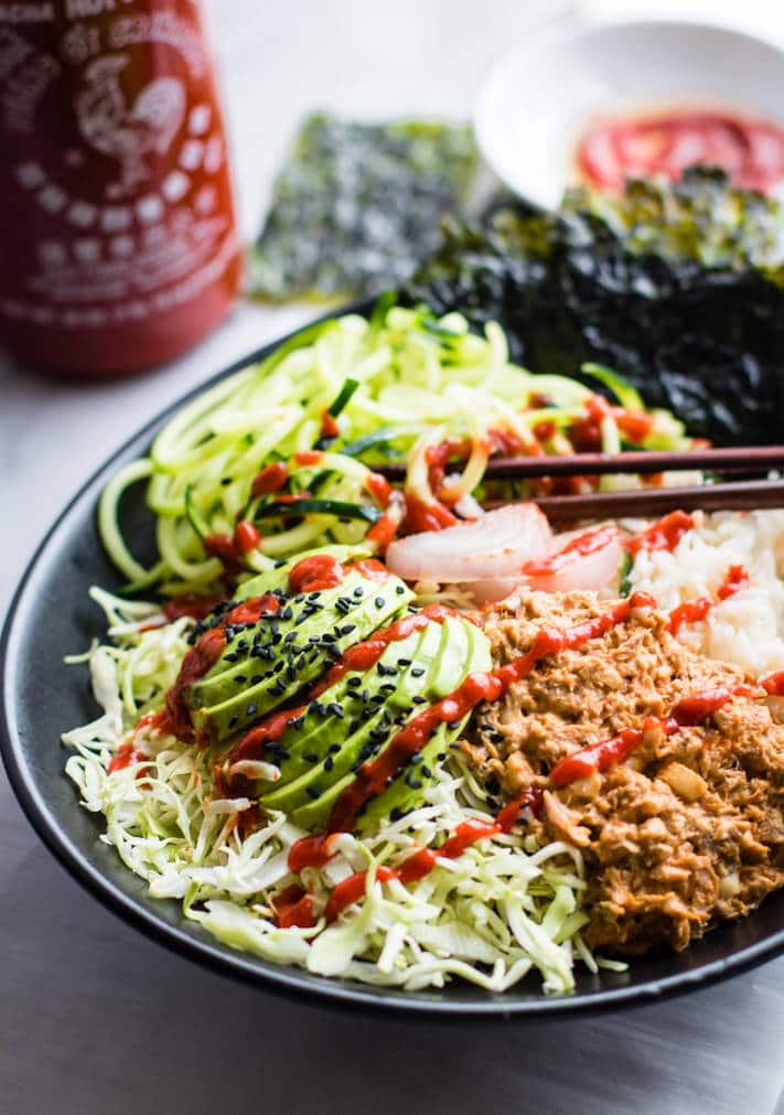 Spicy avocado tuna salad sushi bowls. A protein packed gluten free tuna salad mixed with healthy sushi ingredients, then tossed all in a bowl.