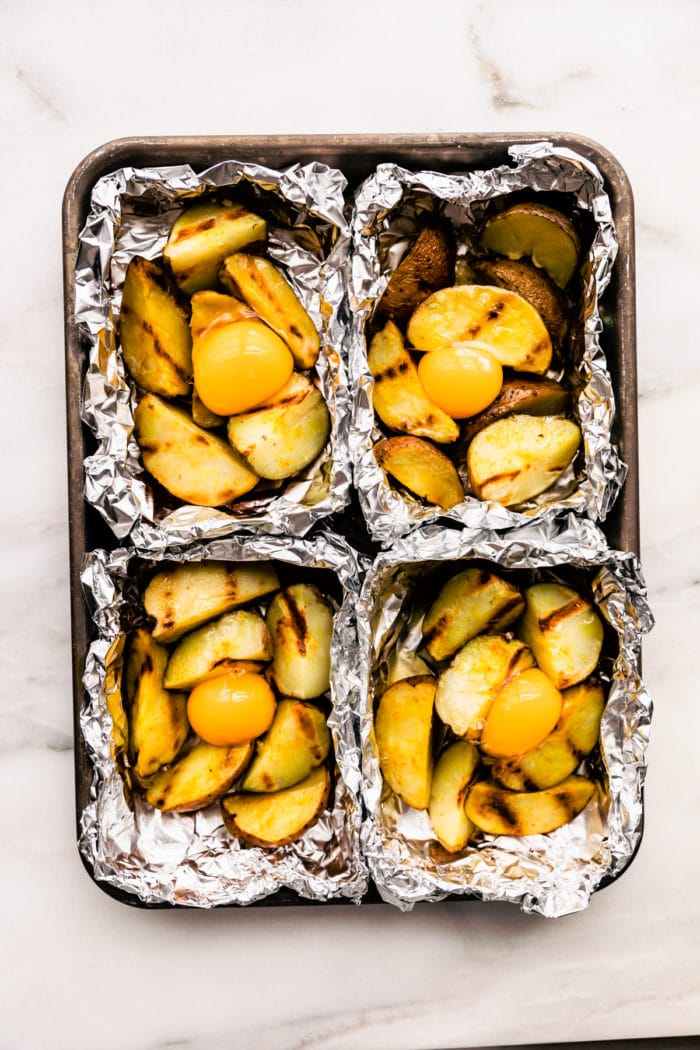 grilled potatoes in aluminum foil grilling packets