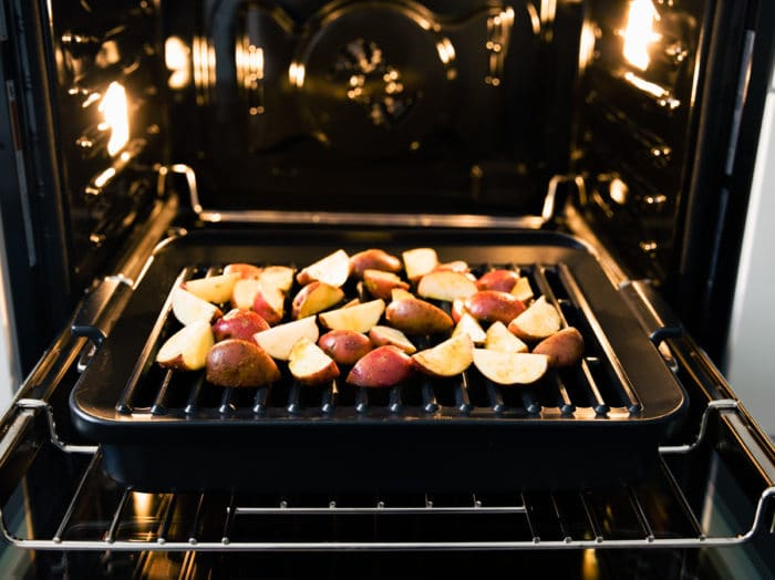 potatoes wedges on sheet pan in oven