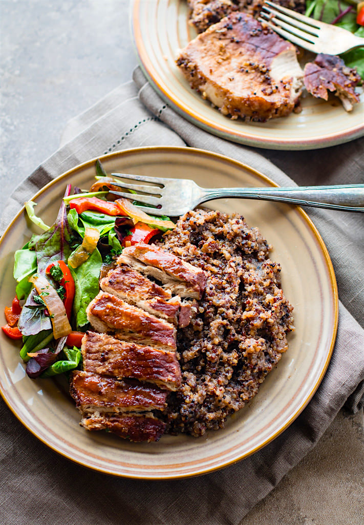 Easy Gluten free ONE-POT BBQ Cherry Pork Chops and Quinoa. A super simple gluten free one-pot meal that feeds the family. Finally, a healthy one-pot BBQ recipe that also makes a great recovery meal. It's balanced in carbs, protein, and healthy fats. Plus loaded with anti-inflammatory properties! Good and plenty for the whole family!