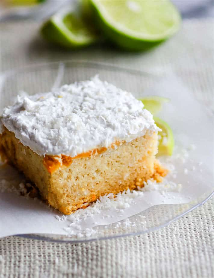 Super EASY gluten free lemon lime coconut vegan cake topped with fluffy whipped coconut cream frosting. An allergy friendly vegan cake that's perfect for Spring/Summer and so simple to make! All you need are a few REAL FOOD ingredients and 45 minutes to bake. @cottercrunch