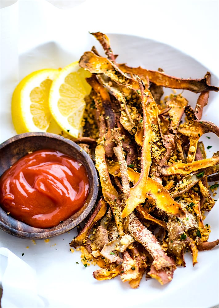 Healthy Oven Baked Parmesan Sweet Potato Skin Fries! Super simple oven baked sweet potato skin fries made from leftover potato skin peels. Easy to make with ANY root vegetable and paleo friendly.