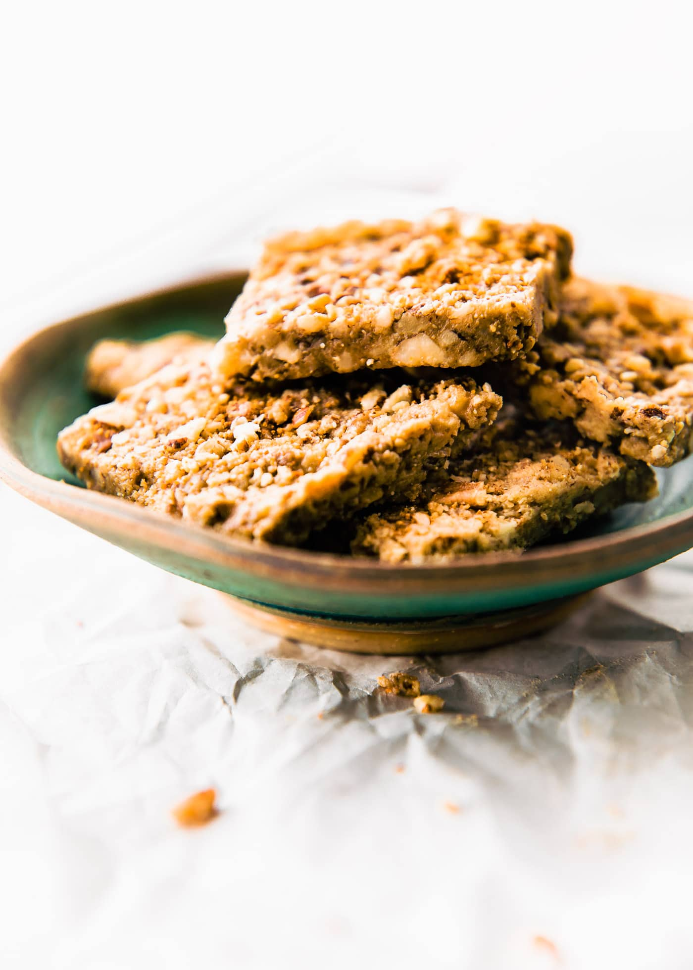 Paleo Baklava Flavored Bars layered in a bowl