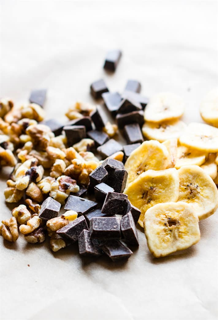paleo trail mix recipe ingredients: banana chips, nuts, and vegan chocolate chunks