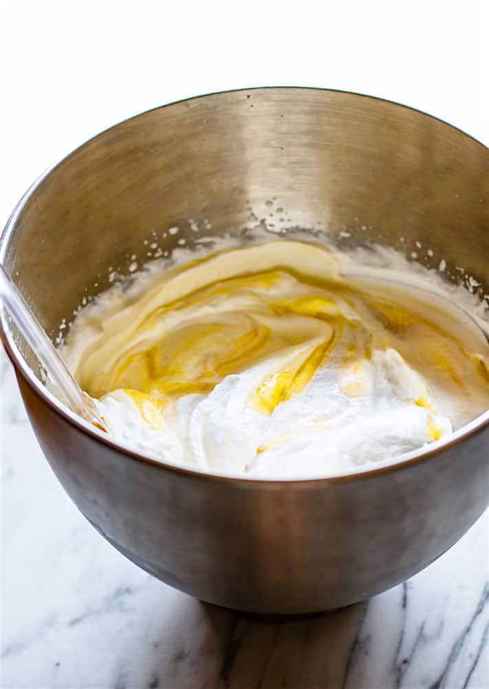 mixing ingredients in a bowl to make a homemade ice cream recipe