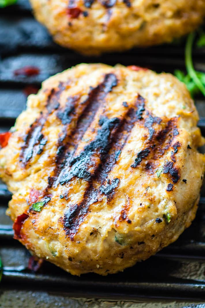 Grilled Adobo Chicken Burgers. Mexican and Filipino style adobo chicken flavors all mixed together then grilled to perfection. Healthy, easy, and Gluten free Chicken Burgers!