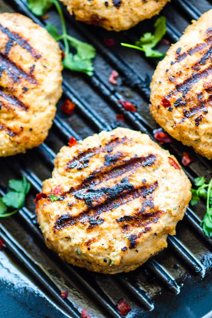 Grilled Adobo Chicken Burgers. A fusion of delicious Filipino and Mexican style adobo chicken flavors all mixed together and grilled up to make one TASTY chicken burger! These Chicken burgers are simple to make, healthy, gluten free, dairy free, and unreal GOOD! Perfect BBQ food if you ask me!