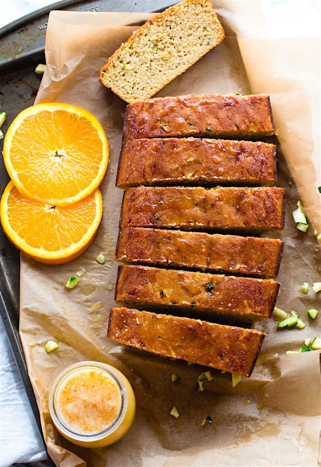 Zesty Orange Cream Paleo Zucchini Bread! A classic zucchini bread recipe made healthy, paleo, and packed with vitamin C! This paleo zucchini bread is an easy to make and super refreshing with a ginger glaze to drizzle on top. One of our favorites year round!