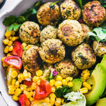 falafel balls in a pan with corn, avocado, and tomato! Lime to top.