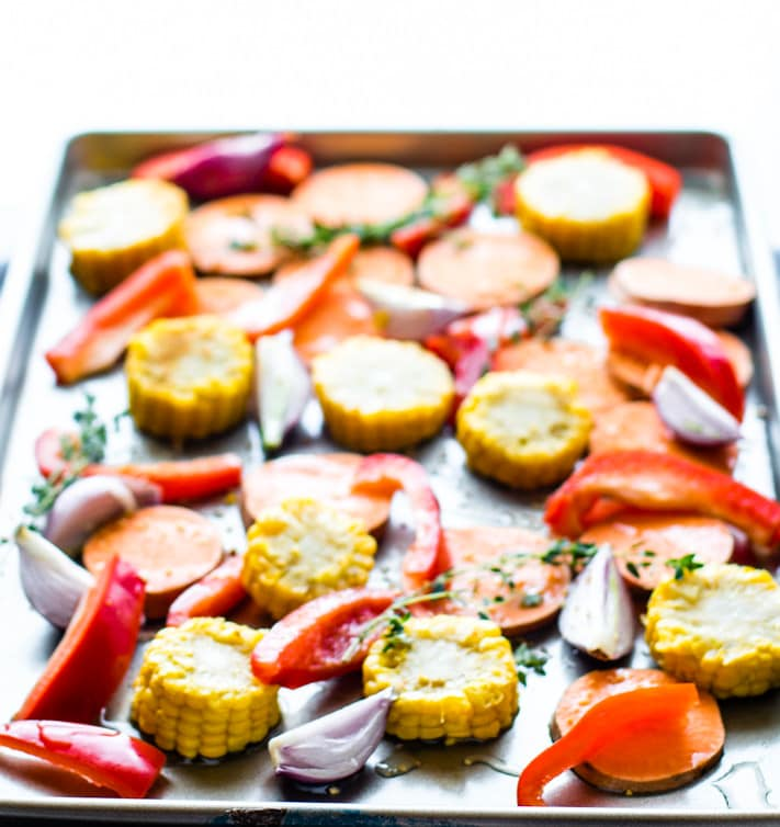 Easy Sheet Pan Jerk Salmon with Veggies! Flavorful Jerk salmon recipe with seasonal veggies baked all on one sheet pan. A wholesome protein packed one pan meal that nourishes the whole family! Did I mention EASY cleanup? Yes!
