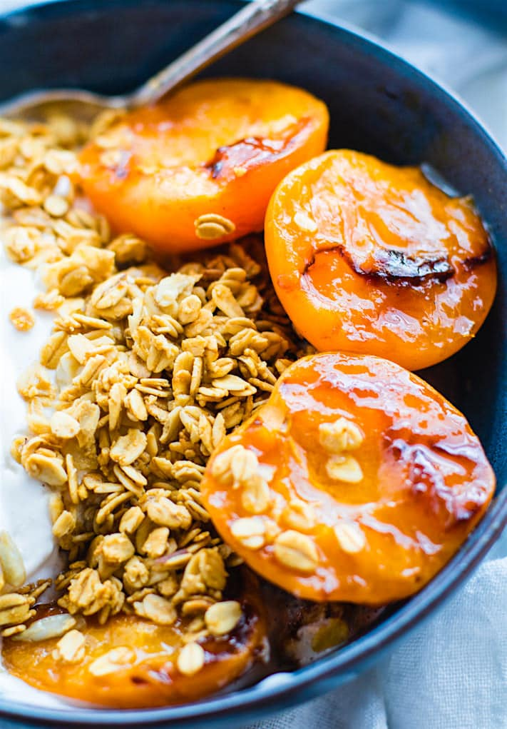 Gluten Free Char-grilled apricot parfait dessert bowls! These dessert bowls are great for dessert or breakfast. A light and simple dessert that's layered across with glazed grilled apricots, whipped coconut cream, and wholesome granola. dairy free.