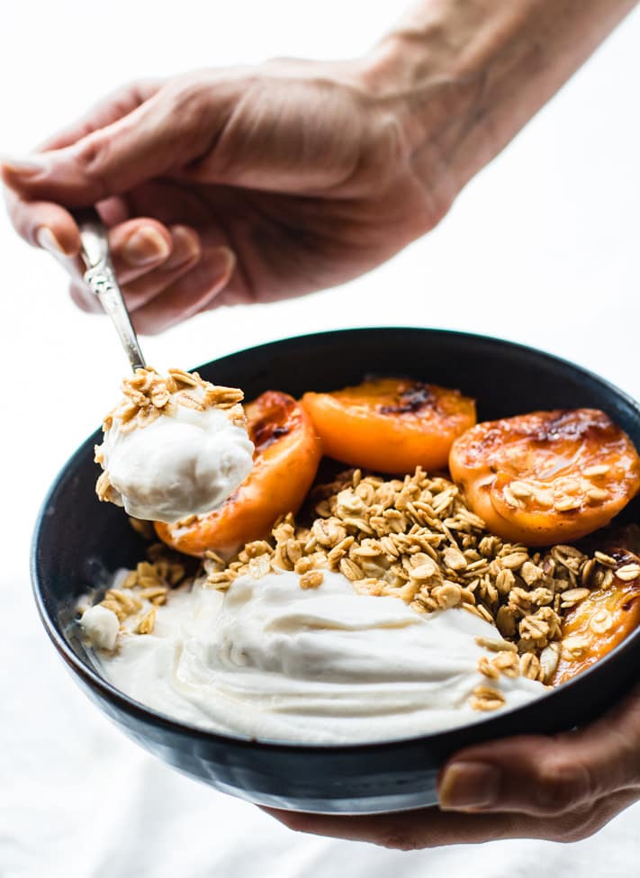 Gluten Free Char-grilled apricot parfait dessert bowls! These dessert bowls are great for dessert or breakfast. A light and simple dessert that's layered across with glazed grilled apricots, whipped coconut cream, and wholesome granola. Vegan Friendly.