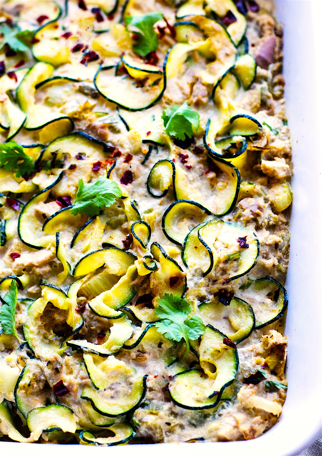 Paleo Tuna Green Chile Zoodle Casserole. An EASY paleo tuna zucchini noodle casserole that's Whole 30 approved, high protein, low carb. Hearty yet healthy, this dish can feed a family! A great way to use your spiralizer and boost your nutrition.