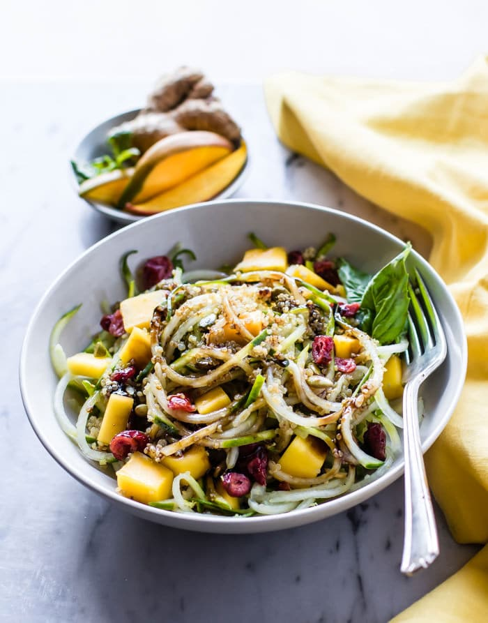 Zesty Mango Spiralized Cucumber Salad. Grab your spiralizer and make this Light Vegan Cucumber Salad! Fresh Mango, Ginger, Cucumber, Quinoa, and dressing!.