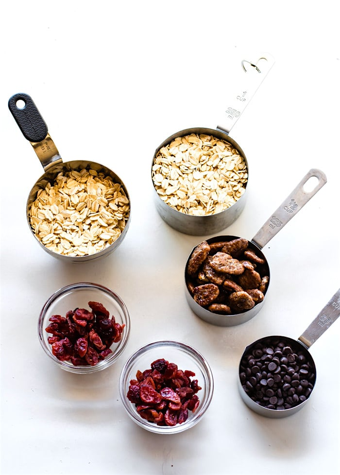 measuring cups of ingredients to make No Bake Oatmeal Cookies Energy Bites