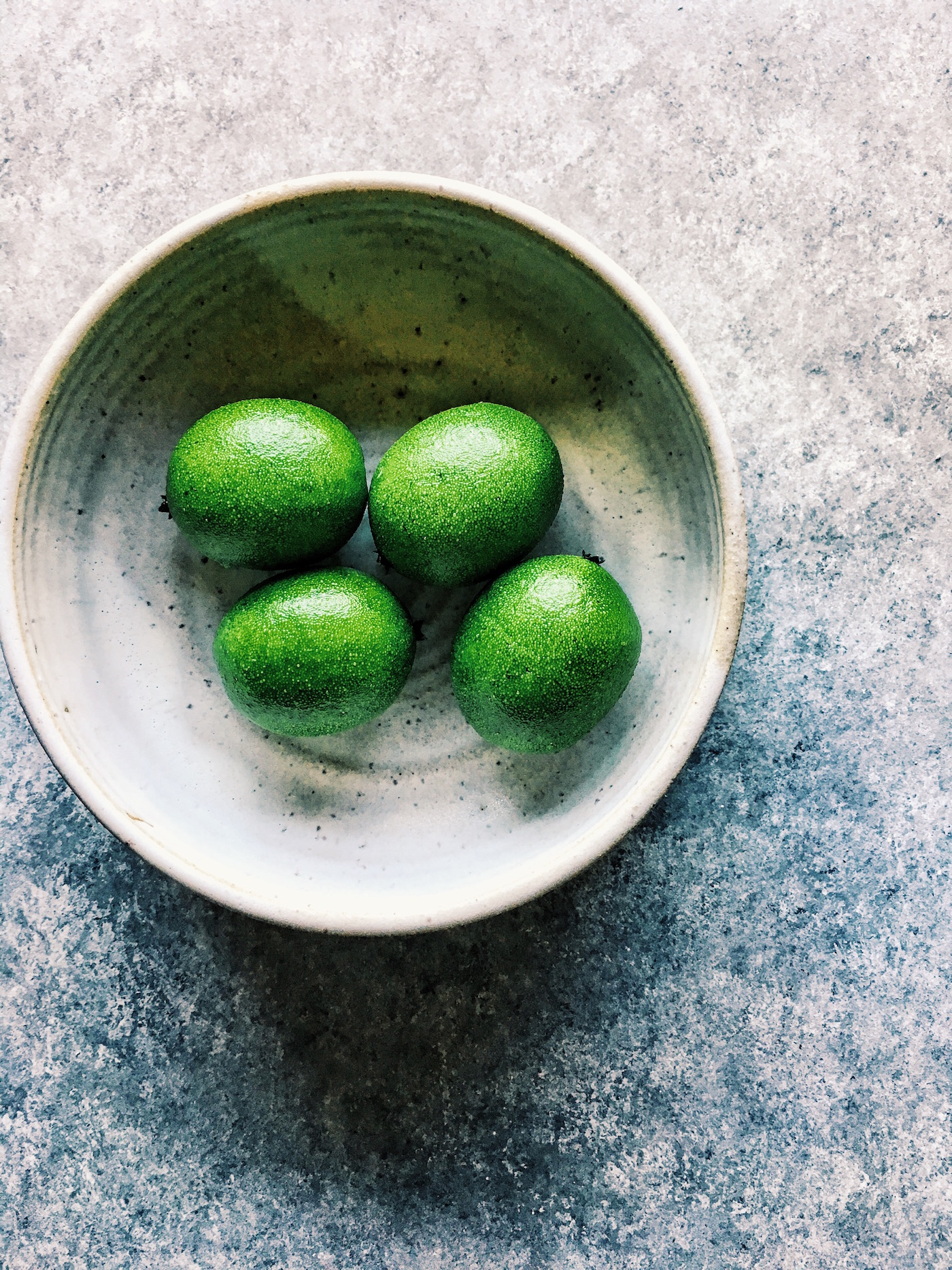 fresh limes in a bowl