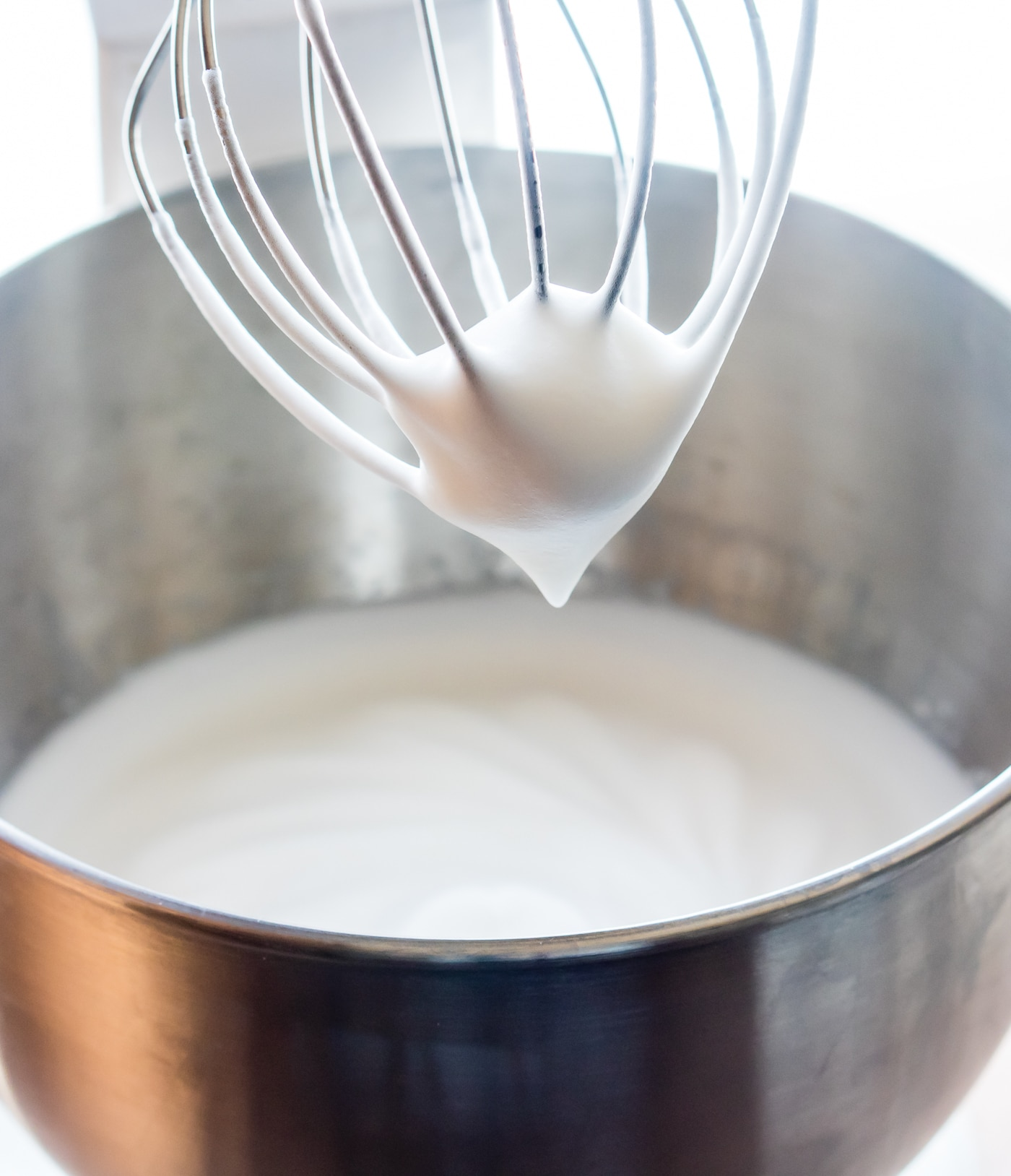 aquafaba in the bowl of a stand mixer