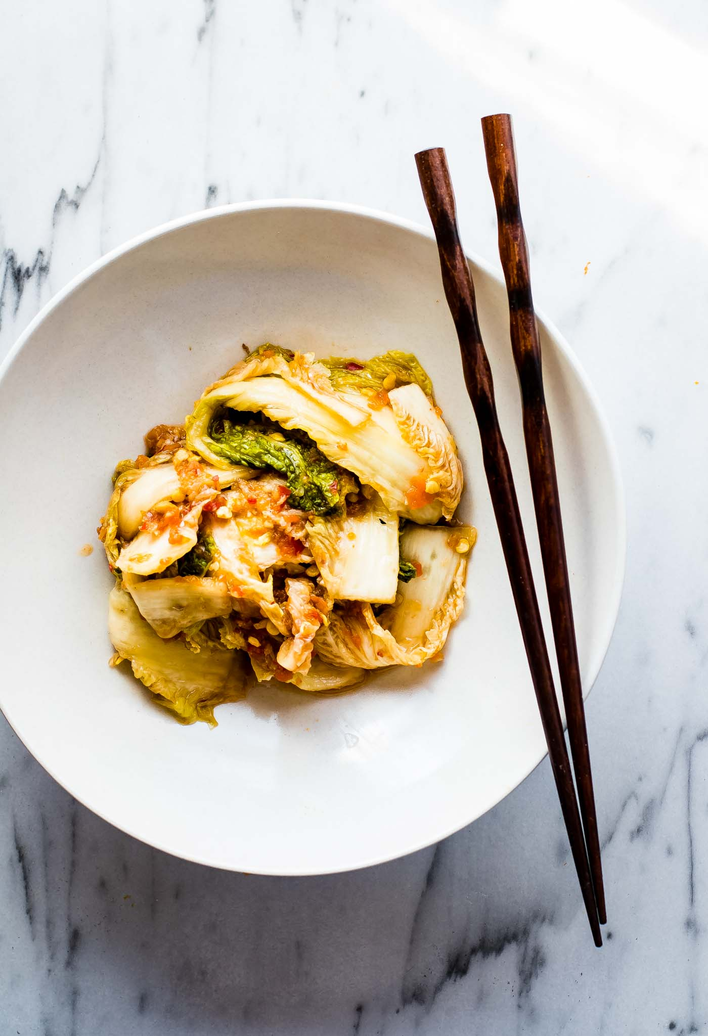 Asian Southwest Fusion EASY Kimchi Recipe. A spicy, tangy, and oh so Easy kimchi recipe! This paleo Asian Southwest Fusion style kimchi takes 10 minutes to make. The hardest part is waiting for it to ferment.. Yep, a healthy side or topping to any dish. Vegan Friendly.
