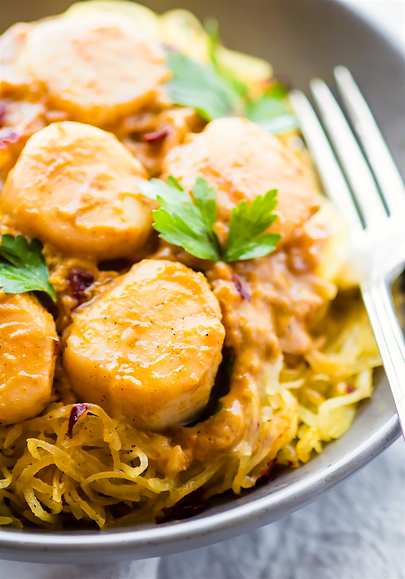Spaghetti Squash Pasta makes for an easy paleo pasta alternative! This gluten free Seafood Pumpkin Spaghetti Squash Pasta is topped with a miso pumpkin sauce and buttery scallops. A healthy lower carb version of your favorite pasta dish. DIG IN!
